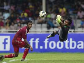 Bangladesh goalkeeper Rasel Mahmud (R) jumps to save the ball as teammate Mohammed Yasin Khan looks on during the Asia Group B FIFA World Cup 2018 qualifying match against Tajikistan at the Bangabandhu National Stadium in Dhaka on June 16, 2015