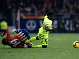 Ligue 1 and the Premier League could be Umtiti's (R) next destinations. AFP