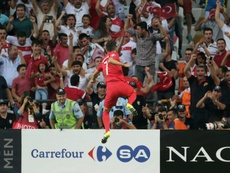 Turkeys midfielder Oguzhan Ozyakup celebrates after scoring a goal against Netherlands during a Euro 2016 qualifying match at the Arena Stadium in Konya, on September 6, 2015 in Konya