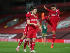 Liverpools Diogo Jota (C) celebrates scoring against Sheffield United. AFP