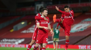 Liverpools Diogo Jota (C) celebrates scoring against Sheffield United. AFP