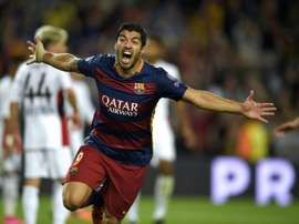 Barcelonas Uruguayan forward Luis Suarez celebrates after scoring a goal during the UEFA Champions League football match FC Barcelona vs Bayer Leverkusen at the Camp Nou stadium in Barcelona on September 29, 2015