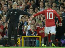 Manchester Uniteds Jose Mourinho (left) acknowledges Wayne Rooney as the striker is substituted during a friendly testimonial against Everton at Old Trafford on August 3, 2016