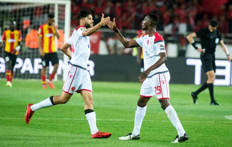 10-man Wydad claw back to hold Esperance in first leg of final. AFP