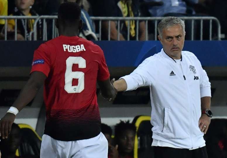 Mourinho and Pogba pictured in Champions League action. AFP
