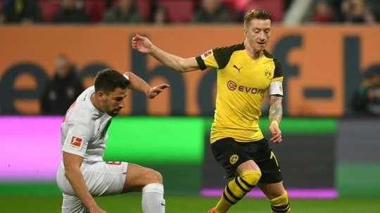 Sporting director believes Reus will end career at Dortmund. AFP