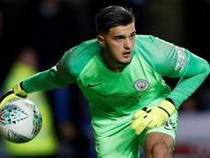 Man City survive shoot-out to reach League Cup semis.