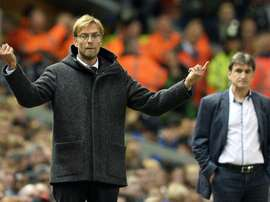 Liverpools manager Jurgen Klopp (L) gestures next to Rubin Kazans counterpart Valeri Chaly during their UEFA Europa League Group B match, at Anfield in Liverpool, on October 22, 2015