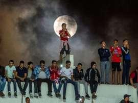 Los hinchas salieron a la calle a celebrar el título. AFP