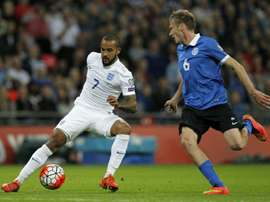 Englands striker Theo Walcott (L) vies for the ball against Estonias Aleksandr Dmitrijev during the Euro 2016 qualifying group E football match between England and Estonia at Wembley Stadium in north London on October 9, 2015