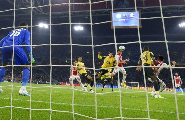 Tagliafico está a dos goles de Cvitanich. AFP