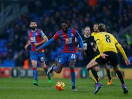 Crystal Palaces Togolese striker Emmanuel Adebayor (C) plays the ball during an English Premier League match at Selhurst Park in south London on February 13, 2016
