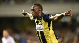 Bolt celebrating scoring a goal for Central Coast Mariners. AFP