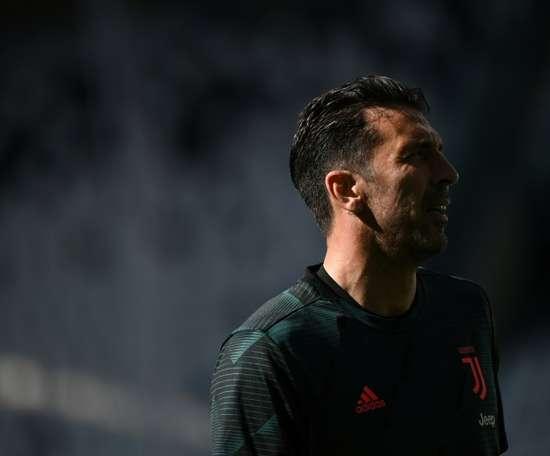 Buffon has broken the appearance record. AFP