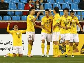 Guangzhou Evergrande players celebrate after scoring a goal in an AFC Champions League match. AFP