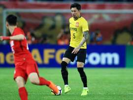 Zhang Linpeng wore a number 15 shirt which was taped to make it look like a 5. AFP