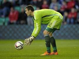 Gordon signs Celtic renewal. AFP