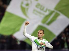 Wolfsburgs forward Bas Dost celebrates at the final whistle of the Group B, first-leg UEFA Champions League football match against Eindhoven on October 21, 2015