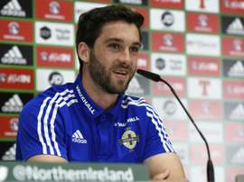 Striker Will Grigg has become a cult hero with Northern Ireland fans. AFP