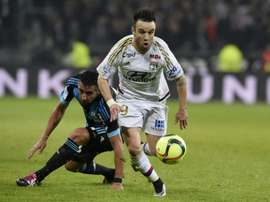 Mathieu Valbuena (upright) plays for Lyon against Marseille on January 24, 2016, at the Parc Olympique Lyonnais stadium in Decines-Charpieu, France