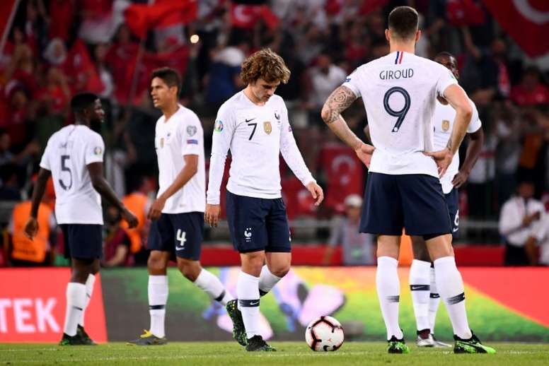 Antoine Griezmann and his France team mate look dejected following a poor defeat. AFP