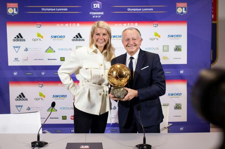Jean-Michel Aulas with Ada Hegerberg and the Balon D'Or. AFP