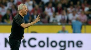 Lucien Favre se blesse en célébrant le but de son équipe. AFP