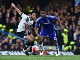John Mikel Obi vying with Tottenham's Moussa Dembele. AFP