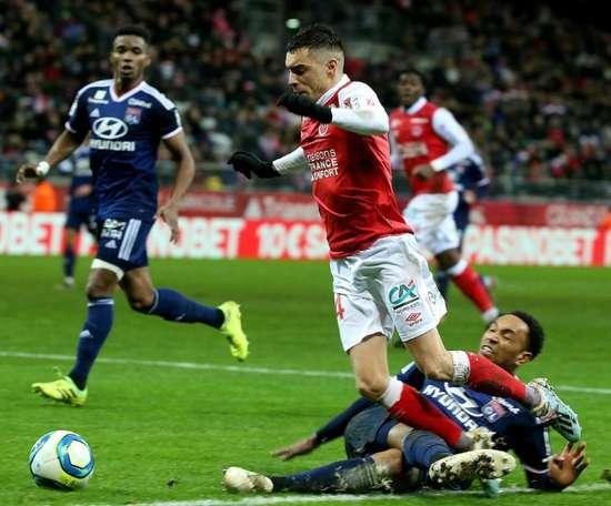 Lyon, frustré à Reims, finit l'année dans le ventre mou. AFP