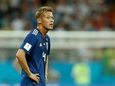 Keisuke Honda lors d'un match face à la Belgique. AFP