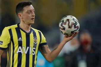 Ozil scored in Fenerbahce's victory against Adana Demirspor. AFP