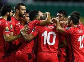 Les joueurs tunisiens se congratulent après un but contre le Zimbabwe lors de la CAN. AFP