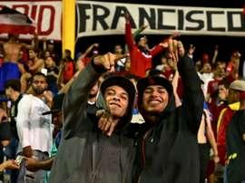 Des supporteurs du FC Cararas lors d'un match de Copa Libertadores face à Melgar. AFP