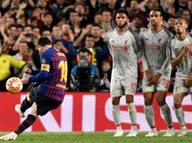 Messi's free kick at the Camp Nou was voted the best goal of the semis by UEFA. AFP