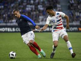 Antonee Robinson (R) has been ruled out for four weeks. AFP