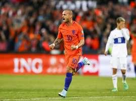 Sneijder confie qu'il aurait pu avoir le niveau de Ronaldo et Messi. AFP