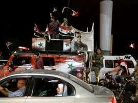 Les supporters syriens fêtant le match nul de leur équipe contre l'Iran à Téhéran. AFP