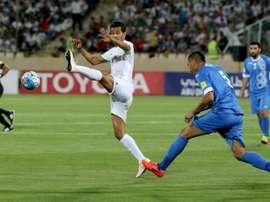 L'Iranien Masoud Shojaei lors dun match face à l'Ouzbékistan en qualifications au Mondial 2018. AFP