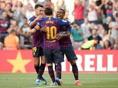 Munir El Haddadi et Lionel Messi félicitent la recrue Malcom, auteur d'un but. AFP