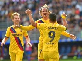 Griezmann, Messi and Suarez all score as Barça comfortably beat Eibar. AFP