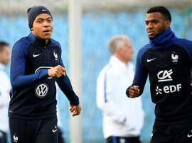 Les Français Kylian Mbappé et Thomas Lemar lors d'un entraînement, le 24 mars à Luxembourg. AFP