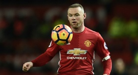 Rooney revealed which players 'controlled' the United dressing room. AFP