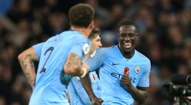 Benjamin Mendy says City are not ready to give up just yet. AFP