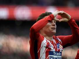 Atletico Madrid will not stop in pursuit of Barcelona, promises Gameiro. AFP
