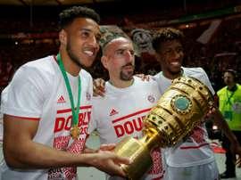Corentin Tolisso (g) et Franck Ribéry lors de la victoire en Coupe d'Allemagne. AFP