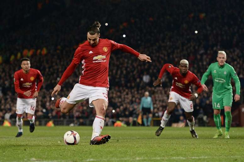 Zlatan kicking the ball. AFP