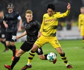 Le milieu Shinji Kagawa et le Borussia Dortmund se sont inclinés sur le terrain. AFP