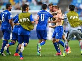 La joie des jeunes Italiens vainqueurs de la Zambie avec un but décisif de Luca Vido (torse nu). AFP