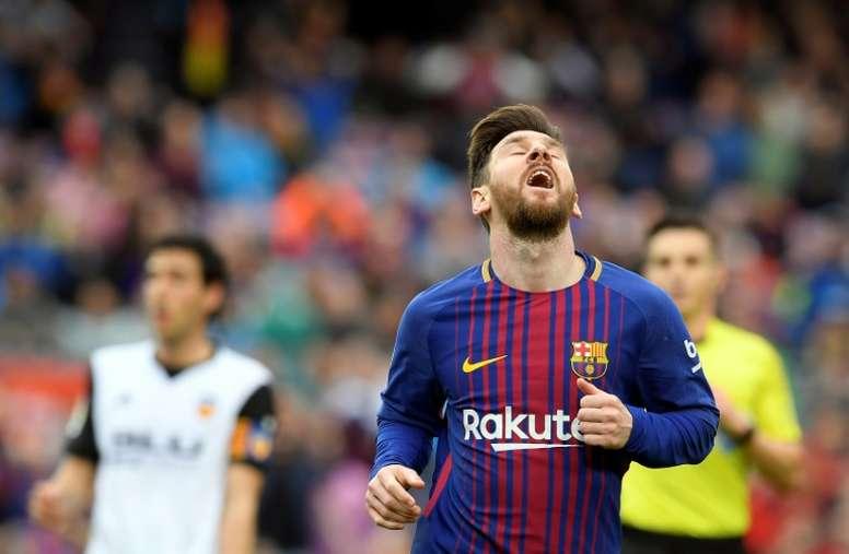 Messi toujours dérangé par sa lésion musculaire. AFP