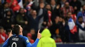Giroud ouvre la porte à un départ. AFP